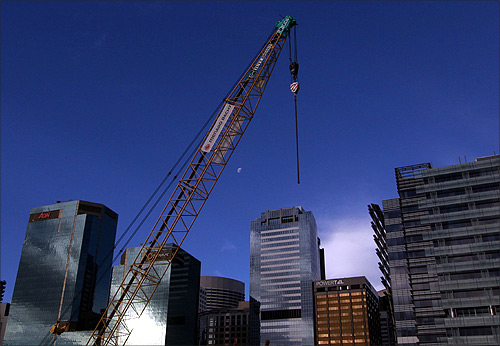 A crane is seen over Sydney's skyline at a construction site in central Sydney.