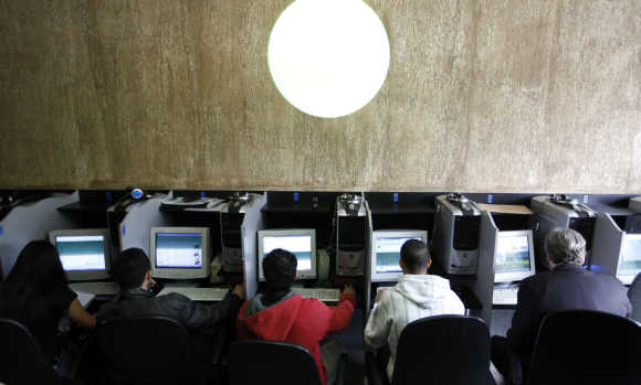 Customers use computers at an Internet cafe in Sao Paulo.