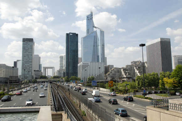 The 'First Tower', France's tallest skyscraper which measures 231 metres, is seen in the business district of La Defense, near Paris.