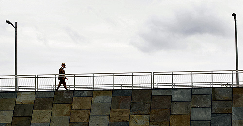 A man strolls the esplanade along the Potomac River at the recently opened Long Bridge Park in Arlington, Virginia.