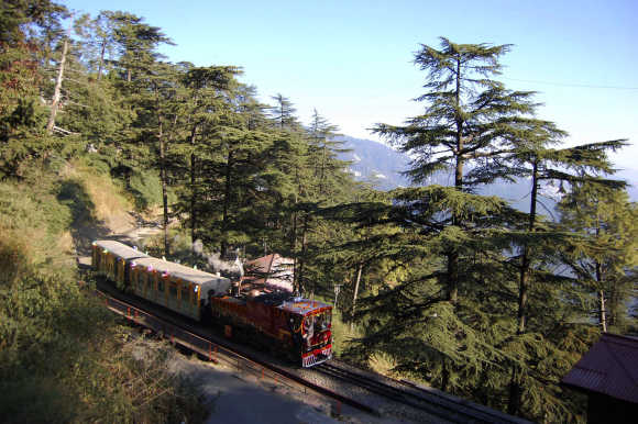 A 103-year-old steam engine runs on the 105-year-old Shimla-Kalka railway track in Shimla.