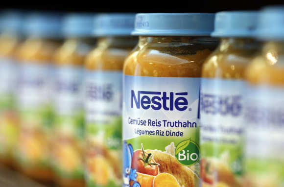Bottles of baby food are seen in the company supermarket at the Nestle headquarters in Vevey, Switzerland.