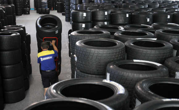 A member of French tyre manufacturer Michelin moves some of 8,000 tyres stocked on the racing circuit of Le Mans, France.