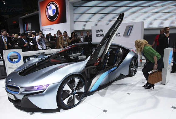 A visitor looks at the BMW i8 plug-in hybrid automobile in New York.