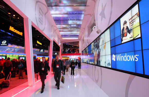 Showgoers walk through the Microsoft booth during the 2012 International Consumer Electronics Show in Las Vegas.