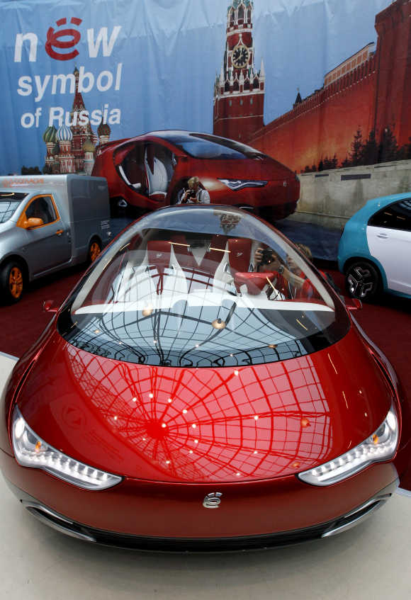 Visitors view a hybrid concept car from Russian car manufacturer e-Auto shown for the first time to the Russian public in St Petersburg.