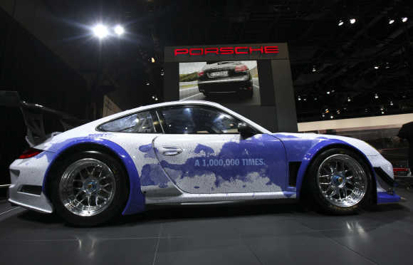 The Porsche 911 GT3 R Hybrid Facebook Race Car is seen at New York International Auto Show.