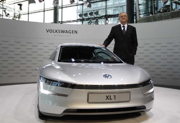 Volkswagen CEO Winterkorn poses beside a XL1 concept car before annual news conference in Wolfsburg, Germany.