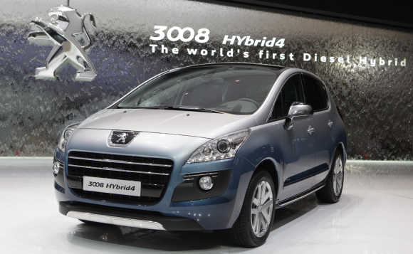 Peugeot 3008 Hybrid4 car is displayed in Geneva.