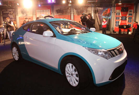 Cross-coupe automobile, produced and designed by Russian billionaire Mikhail Prokhorov