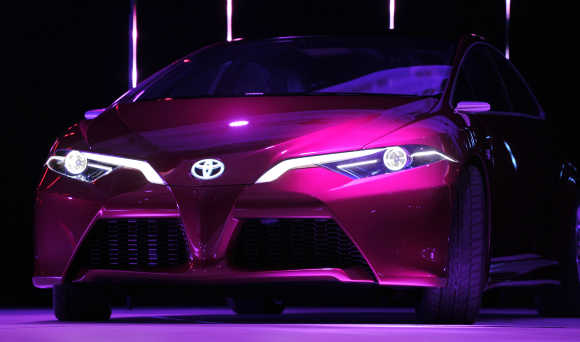 The Toyota NS4 plug-in hybrid concept car is unveiled in Detroit.