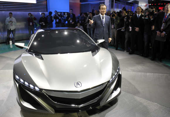 Honda CEO Takanobu Ito unveils the Acura NSX hybrid concept car in Detroit, Michigan.