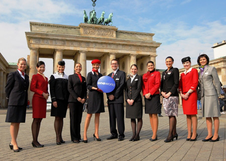 Uniformed representatives from all oneworld member airlines gather in front of Berlin's iconic Brandenburg Gate.