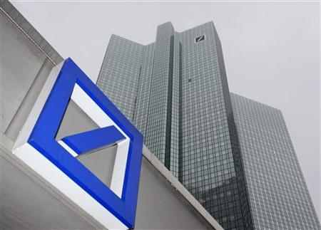 A Deutsche Bank logo is pictured in front of the Deutsche Bank headquarters in Frankfurt.
