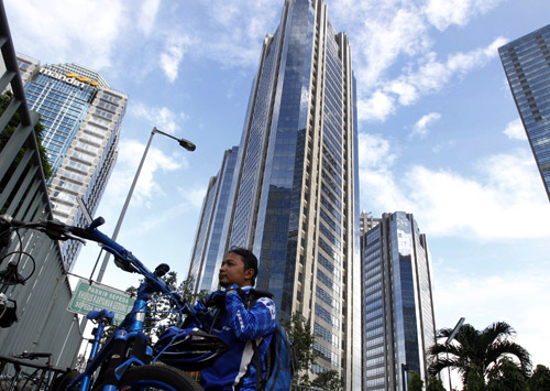 Eka Januar, 33, a manager of an Indonesian company, he arrives at a business district where he works in Jakarta.