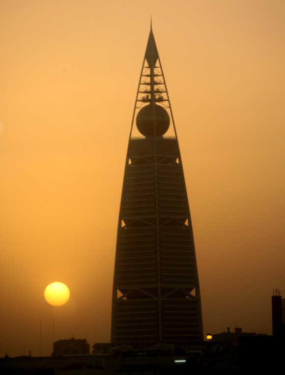 The sun sets behind Borg Al-Faisalya, one of the two main towers in Riyadh.
