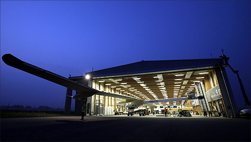 The Solar Impulse aircraft is being pulled out of the hangar for take off at Payerne airport.