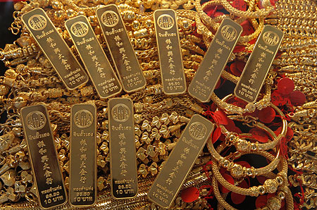 Gold bars and jewellery are displayed in a shop in Bangkok's Chinatown.