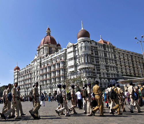 Policemen arrive for deployment at the Taj Mahal Hotel as part of security measures ahead of US President Barack Obama's visit in Mumbai.