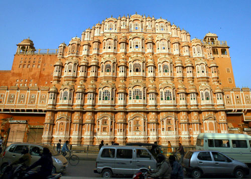 Commuters move in front of Hawa Mahal also known as 'Palace of Winds' in Jaipur.