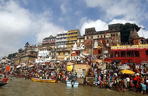 Hindu devotees gather along the banks of River Ganges to watch a total solar eclipse in Varanasi.