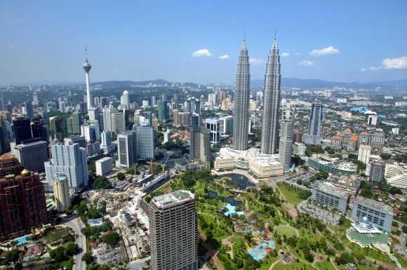 A view of Malaysia's landmark 452-metre Petronas Twin Towers and the 421-metre Kuala Lumpur Tower.