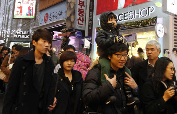 People walk on the street in central Seoul.