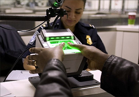 A traveler at Washington Dulles International Airport uses the US-VISIT mechanism that records all 10 fingerprint images.