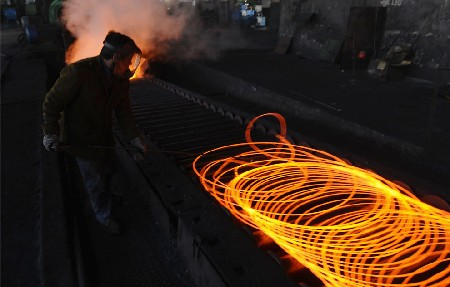 An employee works at a steel factory