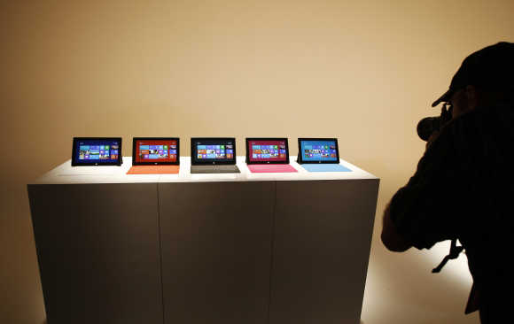 A photographer takes pictures of the Surface tablet computers on display in Los Angeles, California.