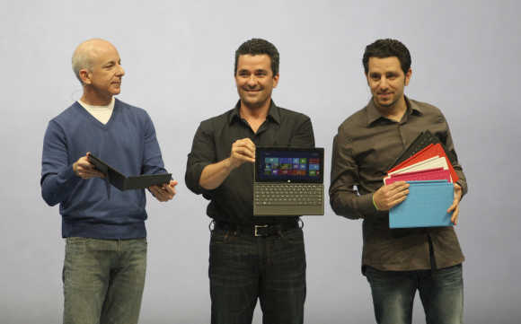 President of the Windows and Windows Live Division Steven Sinofsky, left; Corporate Vice-President of Windows Planning, Hardware and PC Ecosystem, Michael Angiulo; and GM of Microsoft Surface Panos Panay, right, hold the Surface tablet as it is unveiled in Los Angeles, California.
