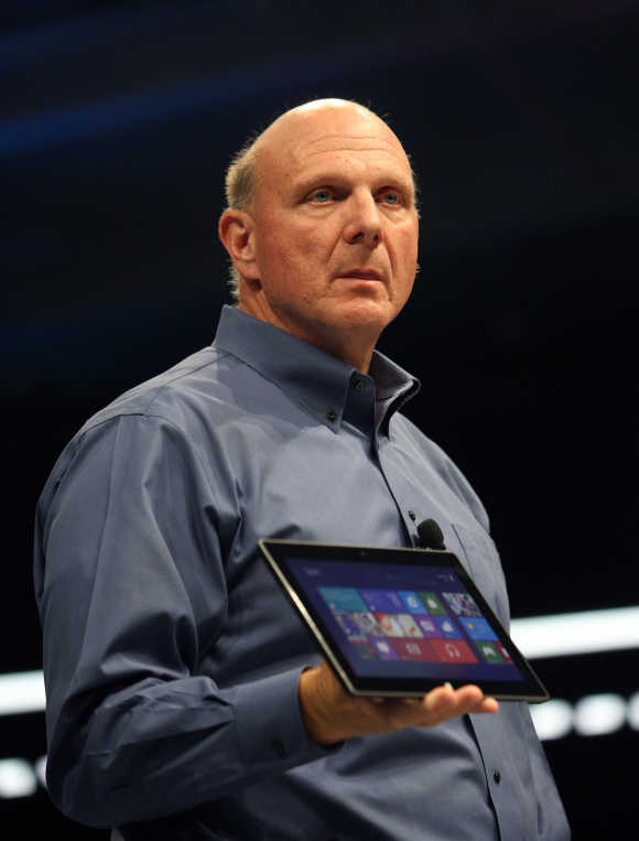 Microsoft CEO Steve Ballmer holds the Surface tablet in Los Angeles, California.