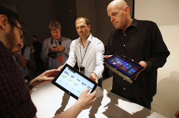 Microsoft representatives show the Surface tablet computer to members of the media in Los Angeles, California.
