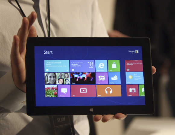 A Microsoft representative holds the Surface tablet computer in Los Angeles, California.