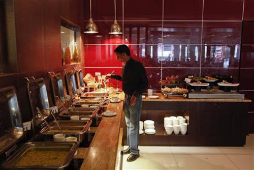 A guest looks at the buffet in a restaurant at the Keys Hotel Nestor in Mumbai.