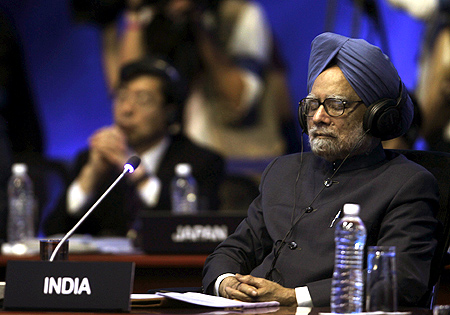 Prime Minister Manmohan Singh waits for the beginning of the first session of the G20 Summit in Los Cabos.