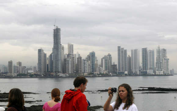 Tourist take pictures of Panama City.
