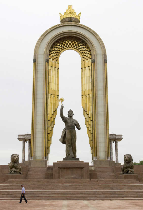 A policeman walks past the monument of Tajik state founder Ismoil Somoni in Dushanbe.