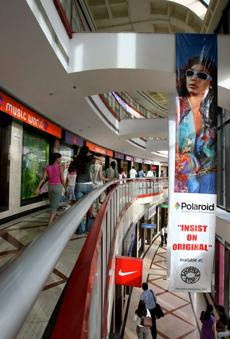 People wander around a shopping mall in New Delhi.