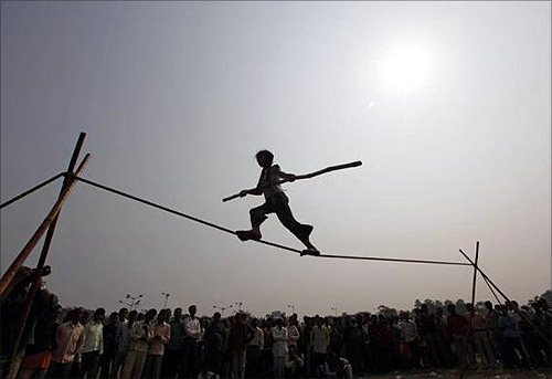Eight-year-old Rupa performs on a tightrope at a roadside in Kolkata.