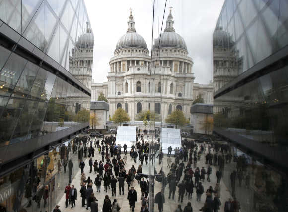 St Paul's Cathedral is reflected on the facade of the One New Change shopping centre in London.