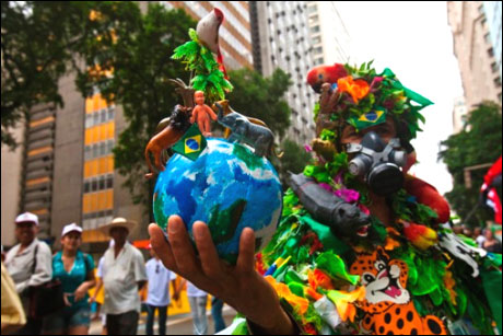 A demonstrator wears a costume that represents the Amazon rainforest during a march at the People's Summit at Rio+20 for Social and Environmental Justice in Rio de Janeiro.
