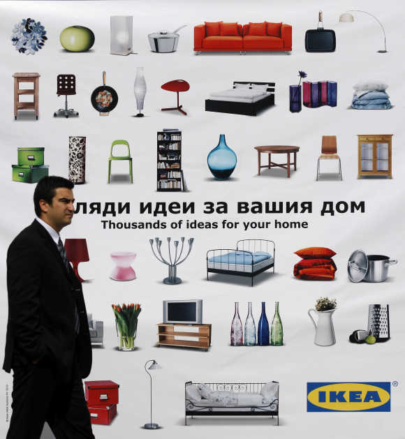 Man walks past advertisement of Swedish flat-pack furniture maker Ikea in Sofia, Bulgaria.