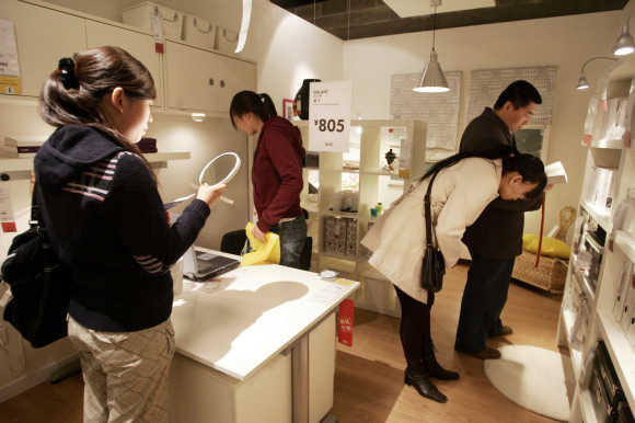 Chinese customers look at products on display at the Ikea store in Beijing.