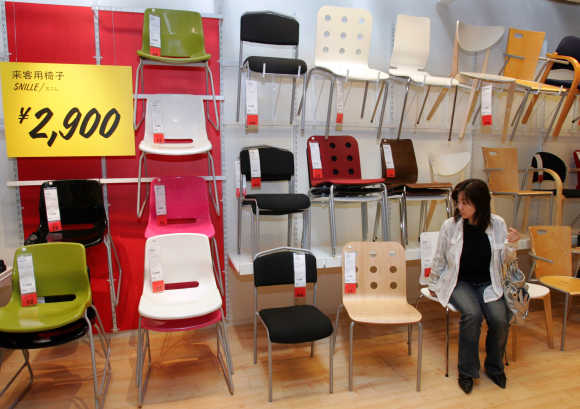 A Japanese woman takes a seat on one of Ikea's chairs at the company's store in Japan in Funabashi, east of Tokyo.