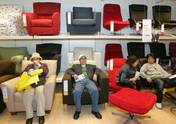 Japanese shoppers sit on Ikea's sofas at a store in Funabashi, east of Tokyo.