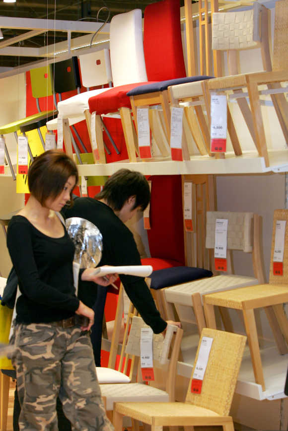 Customers look around at Swedish furniture retailer Ikea's store in Japan in Funabashi, east of Tokyo.