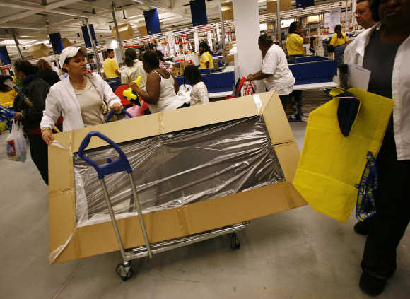 People shop at the Ikea home furnishing store in Brooklyn, New York.