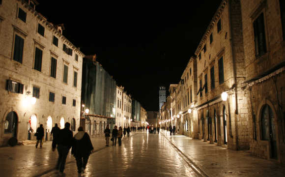 People walk through streets of Croatia's most popular Adriatic destination of Dubrovnik.