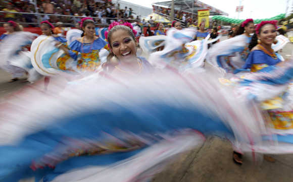 Dancers of Cumbia perform during a parade at the Barranquilla's carnival in Colombia.